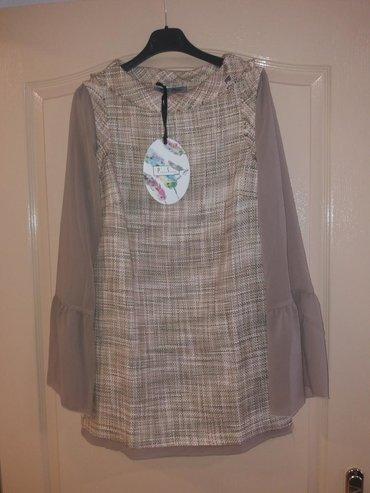 P. s. nova haljinica/tunika, sa etiketom. Pogodna i za poklon jer