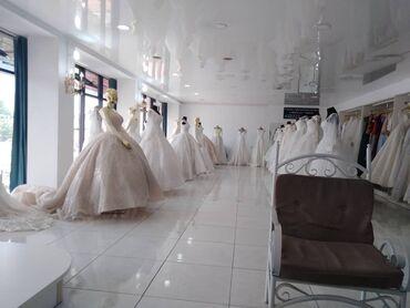 Свадебные платья в г. Жалалабад в подарок идут  причёска  макияж прок