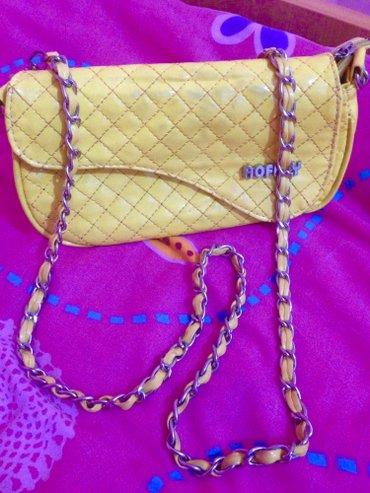 Zuta nova torbica  - Indija
