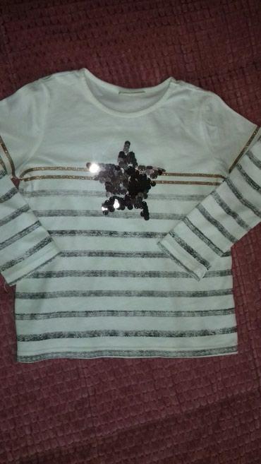 Majica u super stanju.Velicina 110-116.Duzina majice 44cm,duzina - Smederevo
