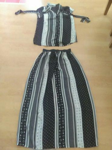 Komplet suknja I kosuljica.Odgovara L/XL vel. Za vise informacija - Bajina Basta