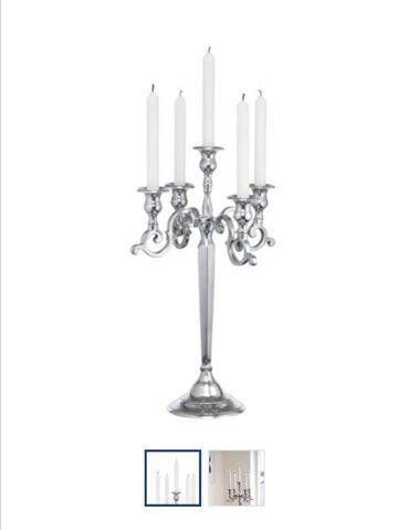 Svećnjak, kupljen u yisku pre 2 god. Plaćen 4000 din, nije korišćen. J