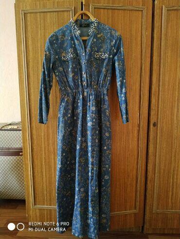 Красивое платье в идеальном состоянии. Размер 44-46, производство