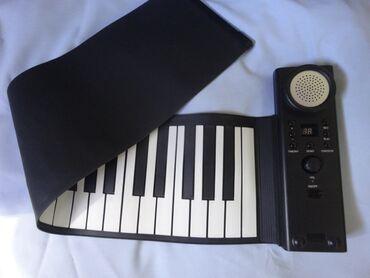 Aro 10 1 6 mt - Srbija: Muzički elastični silikonski rol klavir. Predmet je sa postavljenih