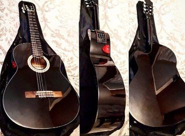 Xaçmaz şəhərində Rivertone firmasinin 2ci əl elektro klassik gitarasi cantasi ile