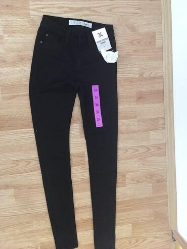 Ženske pantalone | Lebane: Pantalone br 34 za uzrast 12 god. Nove. Iz Nemacke ali nama male. Elas