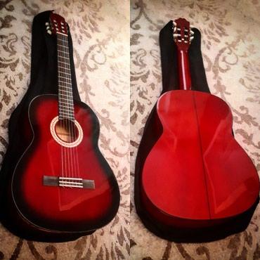 Xaçmaz şəhərində Rivertone firmasının yeni kimi klassik gitarası çantası ilə