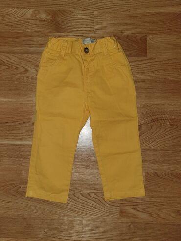 Pantalone zute - Srbija: LC WAIKIKI pantalonice,teget velicina 6-9,zute od 9-12