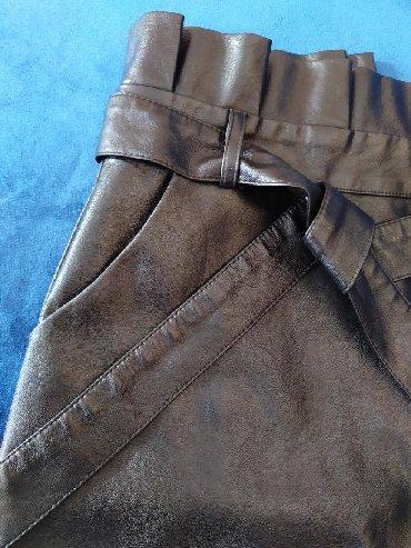 Черная юбка из экокожи. Новая. Размер ее подошёл. С поясом
