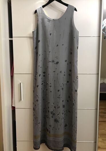 Nenosena duga haljina. Ima postavu. Naznacena velicina M Duzina 137, o