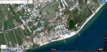 Участок (28х36 м) 10 сот. в с. Комсомол. Расположение: 500 м до в Корумду