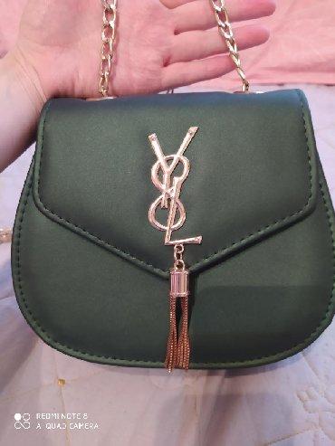 Продаю новую сумочку очень красивого изумрудного цвета, ни разу не выг