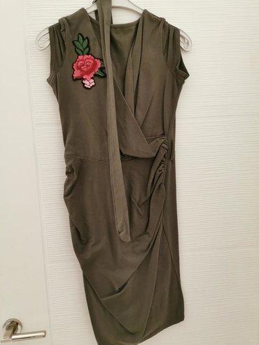 Haljine | Vrsac: Maslinasta haljinaIma pojas koji se vezeUni vel Odg za m/lKoriscena