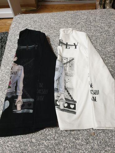 Dve bluzice vel 8  Cena je za obe
