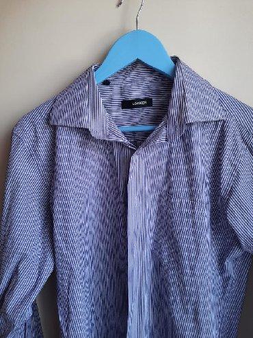 свободная рубашка в Кыргызстан: Свободная рубашка в фиолетовую полоскуможно носить как накидкуразмер