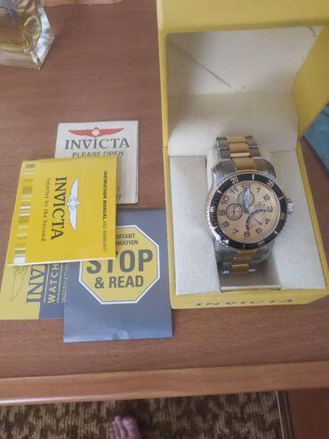 Продаю швейцарские часы Invicta привезли с Канадыне пользовались