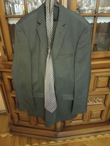 Kastum cemi bir defe geyinilib razmer 54 56