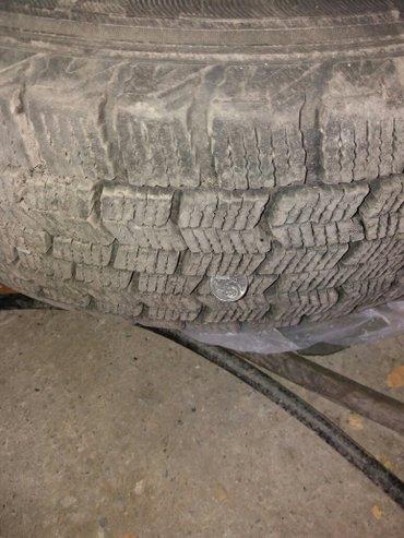 Продаю зимние шины с железными дисками 205х65х15. также есть колпаки.  в Бишкек