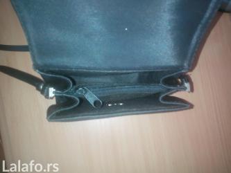 Prodajem torbicu od ripsa, crne boje, potpuno očuvana, nošena samo - Novi Sad