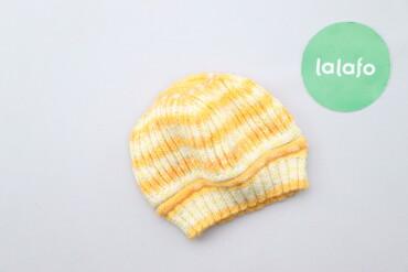 Дитяча в'язана шапка у смужку     Напівобхват голови: 16 см Висота: 16