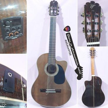 Bakı şəhərində Tagima Ottava- - - Ekvolazerli klassik gitara.