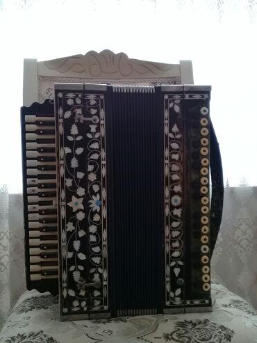28 elan | İDMAN VƏ HOBBI: Qurundik mikrafon 31 qarmonu satılır