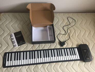 Ostali muzički instrumenti | Srbija: Roll up pianoKupljen nov u Computerland-u, pre dva meseca, ukupno