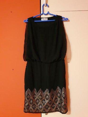 Haljinica sifra - Srbija: Na haljini je veličina 34, ali je može obući i osoba koja nosi 36 Sa