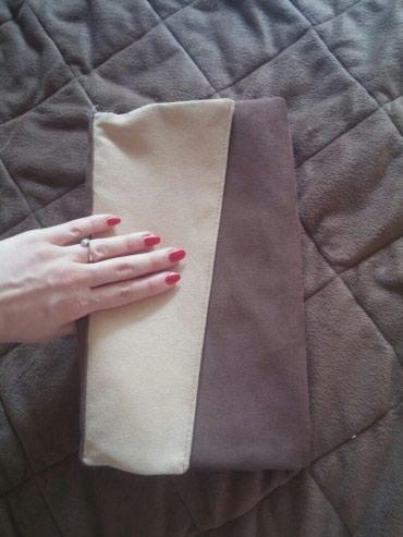 Velika pravougaona torba koja moze da se savije i bude pismo. U dve - Nis