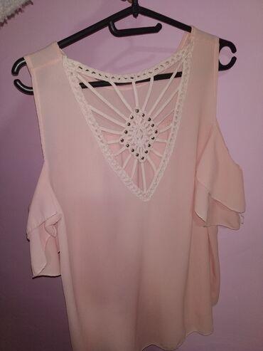 Majica roza,cena je 600