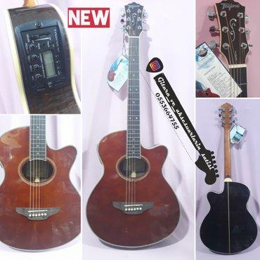 Bakı şəhərində Tagima Ventura --Akustik gitara  Üstündə çanta və şnur hədiyyə olaraq