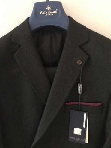 Итальянский новый костюм. Пиджак и брюки. 52 размер