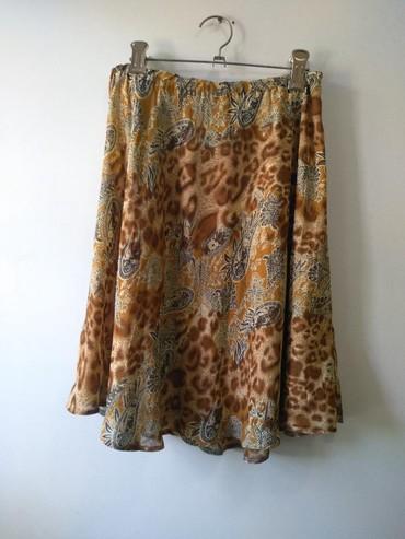 Шифоновая юбочка на резинке, слегка прикрывает коленки. размер 44-46