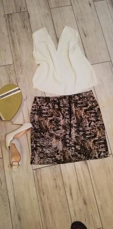 Duzina struk suknja - Srbija: Janina suknja 42. Struk 46cm, duzina 51vm. Struk ima ickure pa moze da