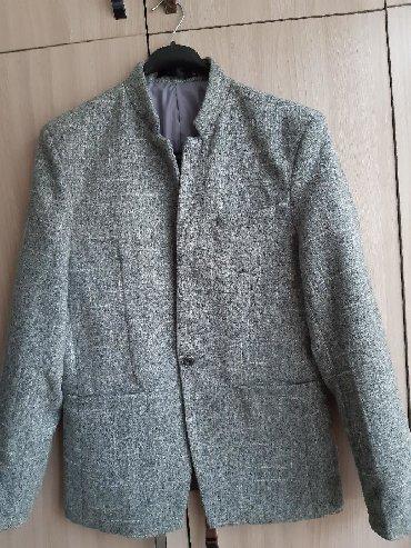 Продаю муж.пиджак. Одевали всего один раз. Состояние идеальное. Размер