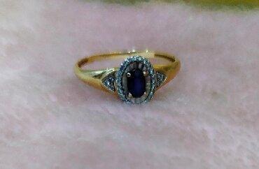 Срочно продаю золотое кольцо с бриллиантами и сапфиром камни