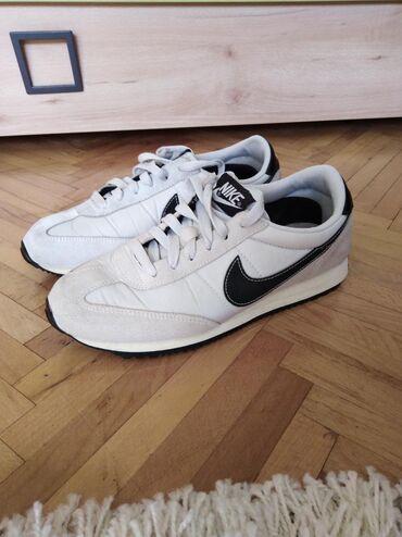 Ženska obuća | Zabalj: Nike patike br. 38,5Dužina ug 24,5 cmKombinacija svetlo sive i crne