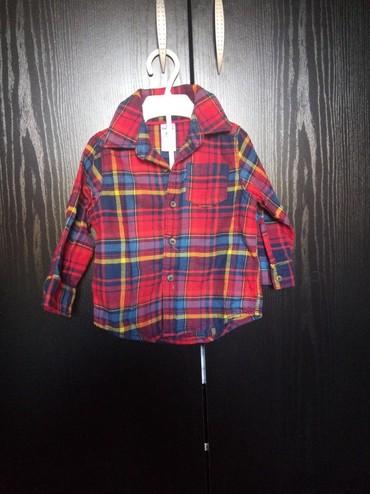 Ostala dečija odeća   Prokuplje: Carters kosuljica nova ne nosena samo je etiketa skinuta. Velicina 86