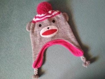 Продам теплую шапку на девочку 3-5 лет, в хорошем состоянии, со штатов в Бишкек