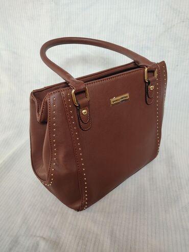 2519 объявлений   СУМКИ: Продаю новую сумку. Сумка из эко кожи. Торг возможен