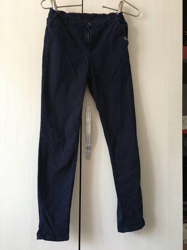 Продаю джинсы на мальчика возраст 12-13 лет,цвет синий, состояние