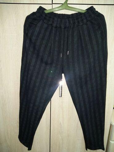 Продаю Брюки женские фирменные 40-42 размера в идеальном состоянии