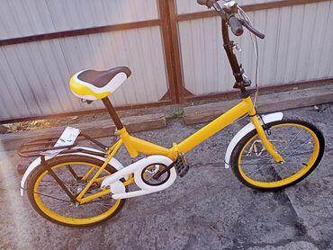 Велосипед жёлто-чёрный-белый новый, ещё не прикрученный с 8 лет, очень