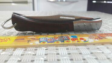 Раскладной нож. Очень качественный, удобный .деревянная рукоять