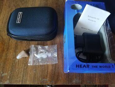 Медтовары - Кара-Балта: Продаётся слуховой аппарат Axon на зарядке в отличном состоянии в