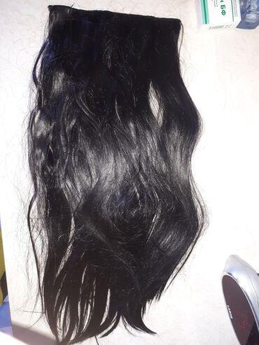 Продаю накладные волосы. 55 см,цвет черный. Покупала для себя,но так и