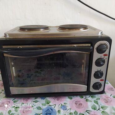 Электроника - Таш-Мойнок: Продаю духовку 2 в одном хорошем состоянии плита тоже работает 2000