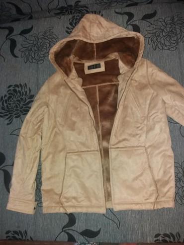 Zenska jakna postavljena velicina ne pise ali mislim da je M. merim po - Paracin