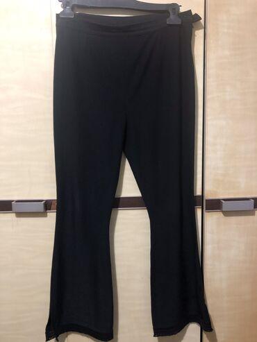 Lagane crne pantalone L velicina sa cipkom na nogavicama
