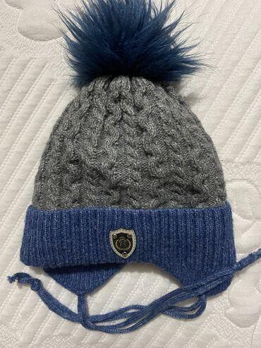 Продаю зимнюю шапочку на мальчика 2-3 годика. Очень теплая